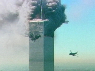 An aircraft, at right, is seen as it is about to fly into the World Trade Center in New York in this image made from television, Tuesday Sept. 11, 2001. The aircraft was the second to fly into the tower Tuesday morning. (AP Photo/ABC via APTN) TV OUT: NO CBS: NO SALES